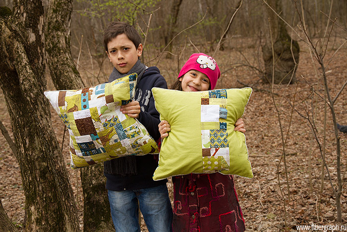 two-green-quilt-pillows-in-the-children-hands