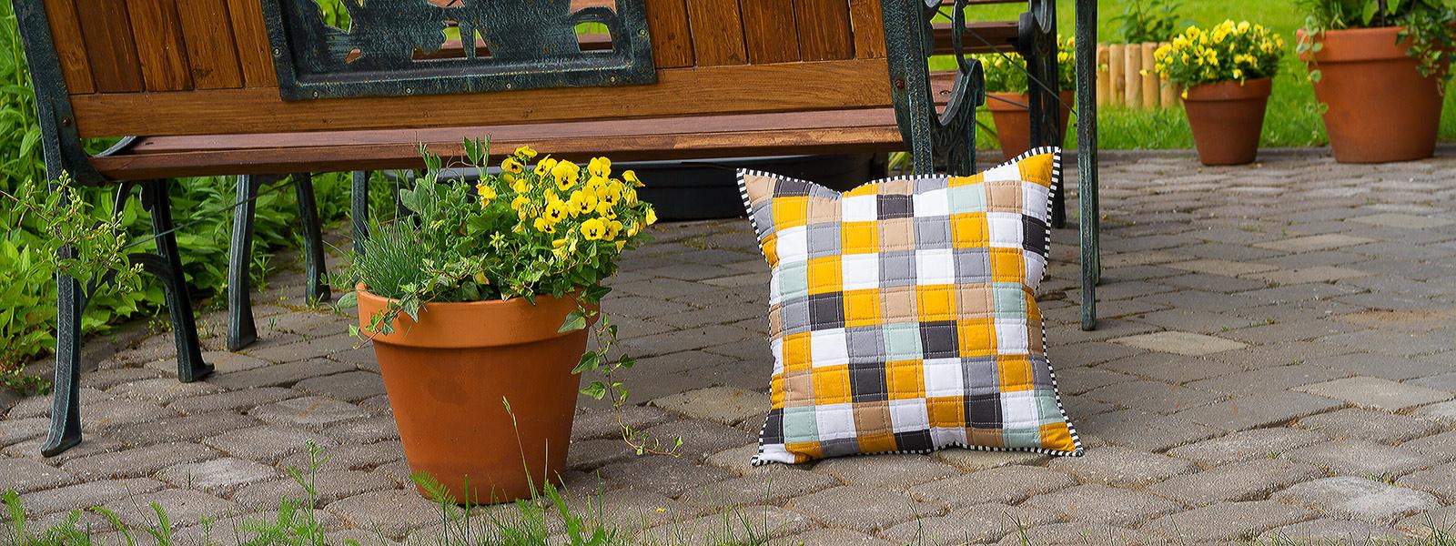 Decorative pillow next to bench