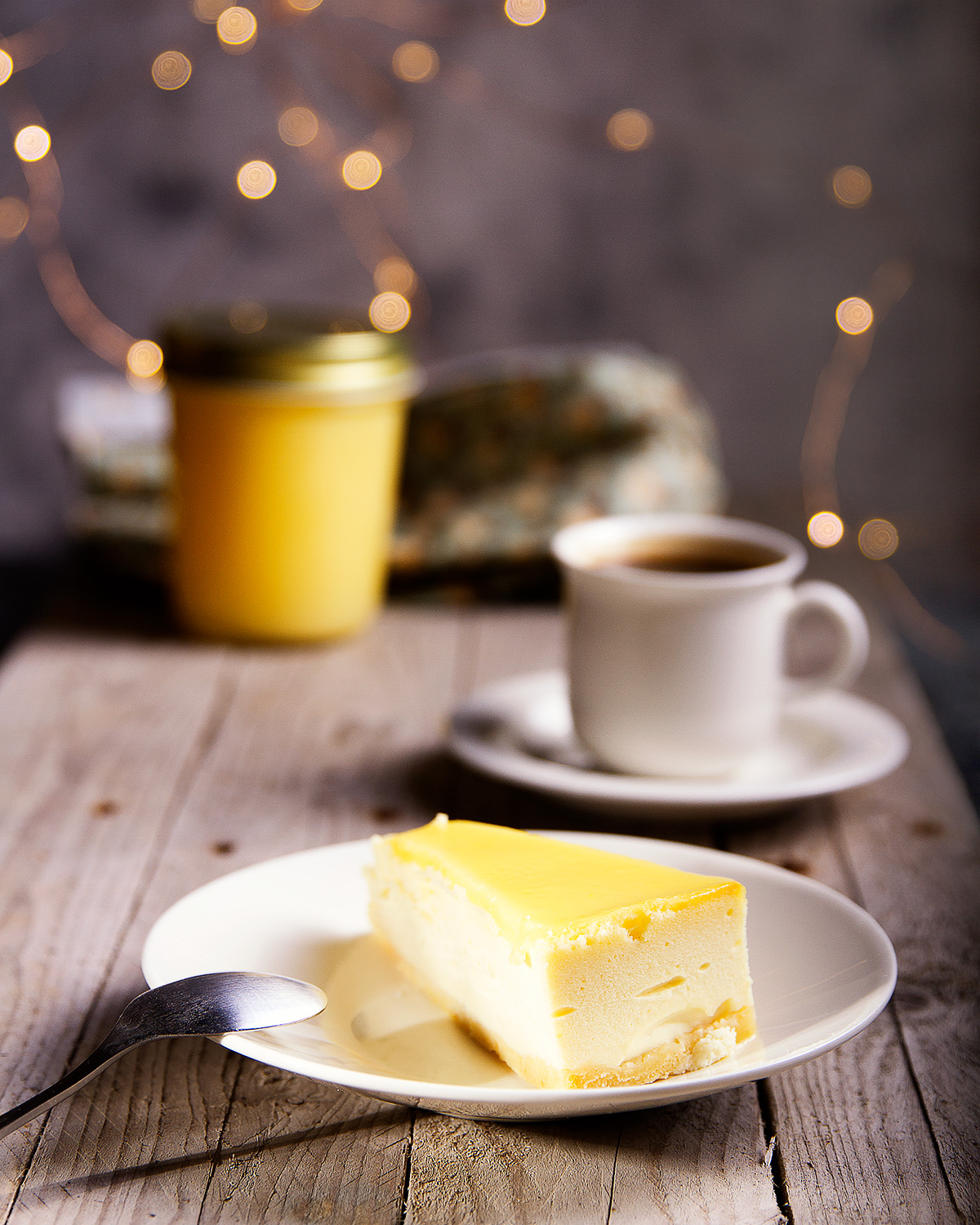 tea setting with cheesecake and lemon curd